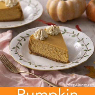 A piece of pumpkin cheesecake with dollops of whipped cream.