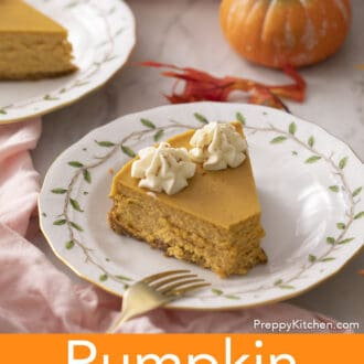 Two pieces of pumpkin cheesecake on porcelain plates.