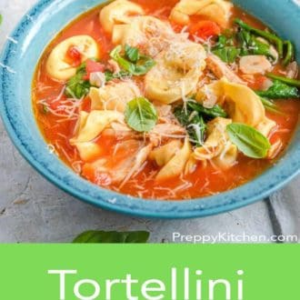 tortellini soup in a blue bowl