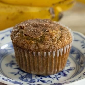 A banana muffin on a blue and white plate.