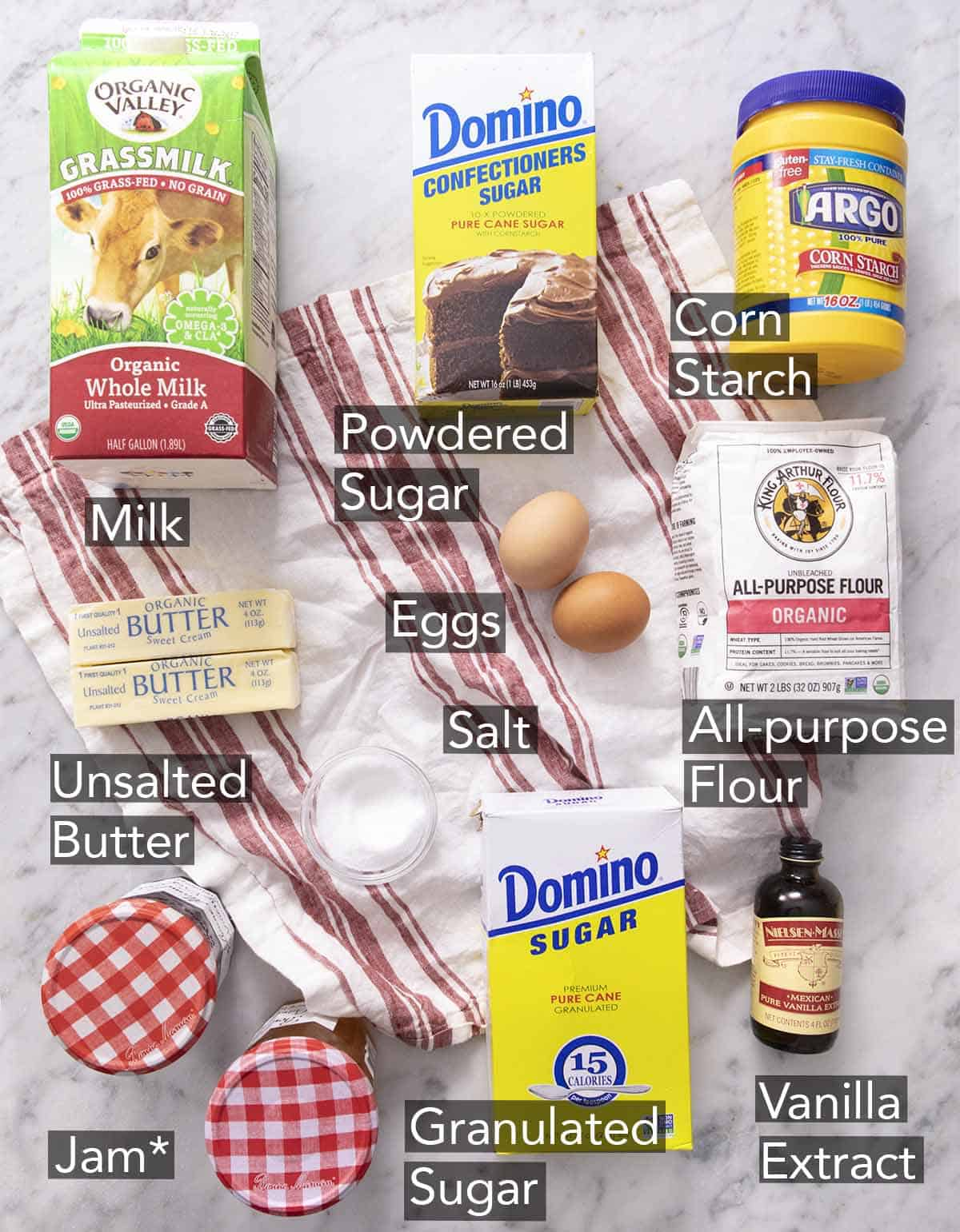 Ingredients needed to make thumbprint cookies on a red and white napkin.