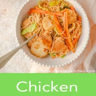 chicken chow mein in a white bowl with fork