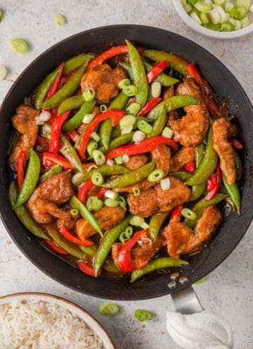 An overhead shot of General Tso's Chicken in a large skillet