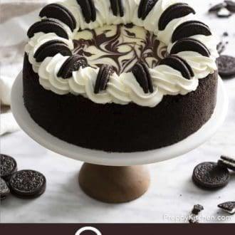 oreo cheesecake on a cake stand