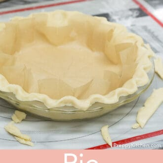 A pie crust wiith parchment paper inside.
