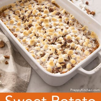 A Sweet Potato Casserole topped with marshmallows in a white baking dish.