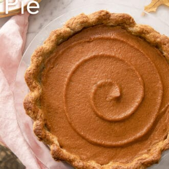 A beautiful sweet potato pie topped with a swirl.