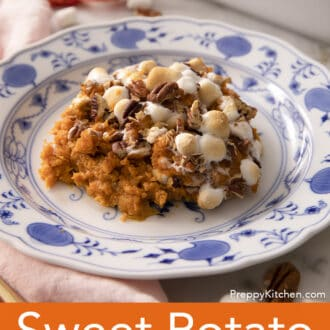 A portion of Sweet Potato Casserole with marshmallows on a plate.