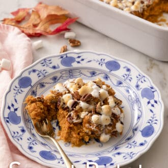 A plate of sweet potato casserole with a gold fork inside.