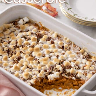 A sweet potato casserole on a marble counter.
