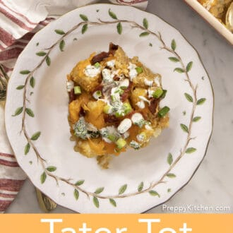 Tater tot casserol with bacon and cheddar cheese on a plate.