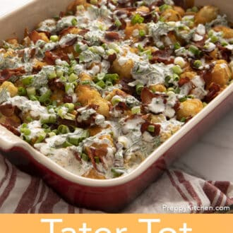 A red baking dish filled with tater tot casserole.