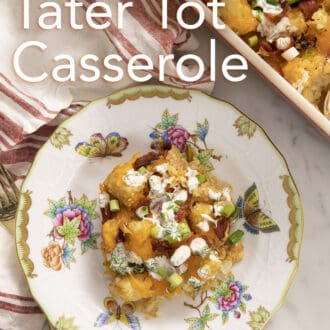 Tater tot casserole topped with homemade ranch on a plate.