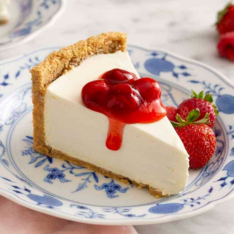 No bake cheesecake topped with cherries.