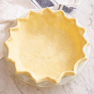 A buttery pie crust ready to be baked.