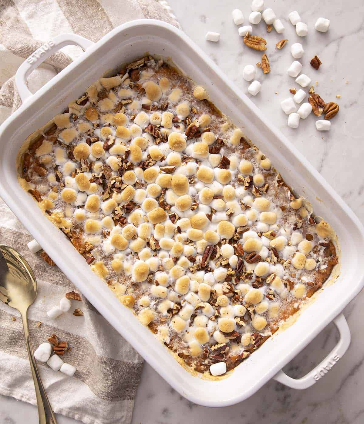 A sweet potato casserole topped with golden marshmallows.