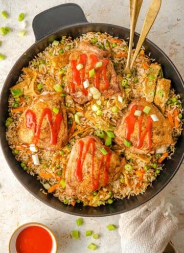 An overhead shot of chicken fried rice in a skillet