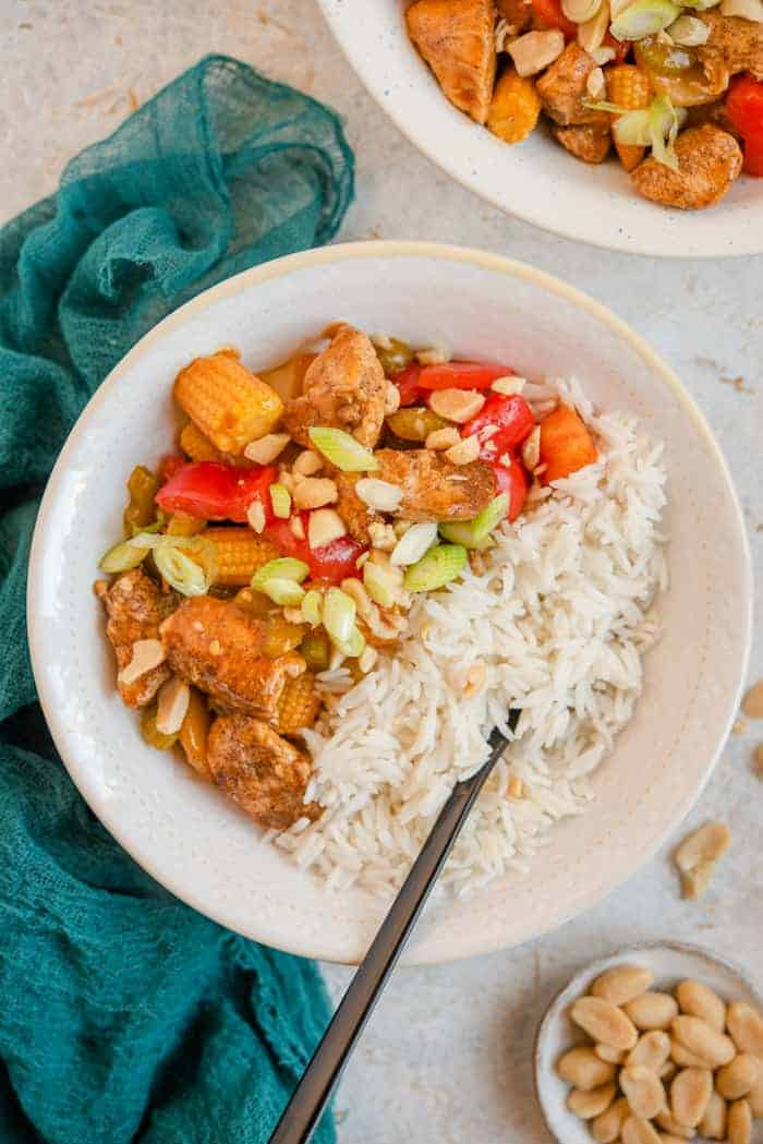 An overhead shot of kung pao chicken in a bowl