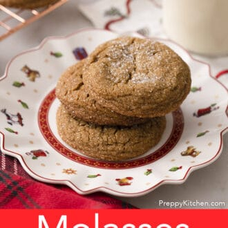 A Christmas plate with three molasses cookies.