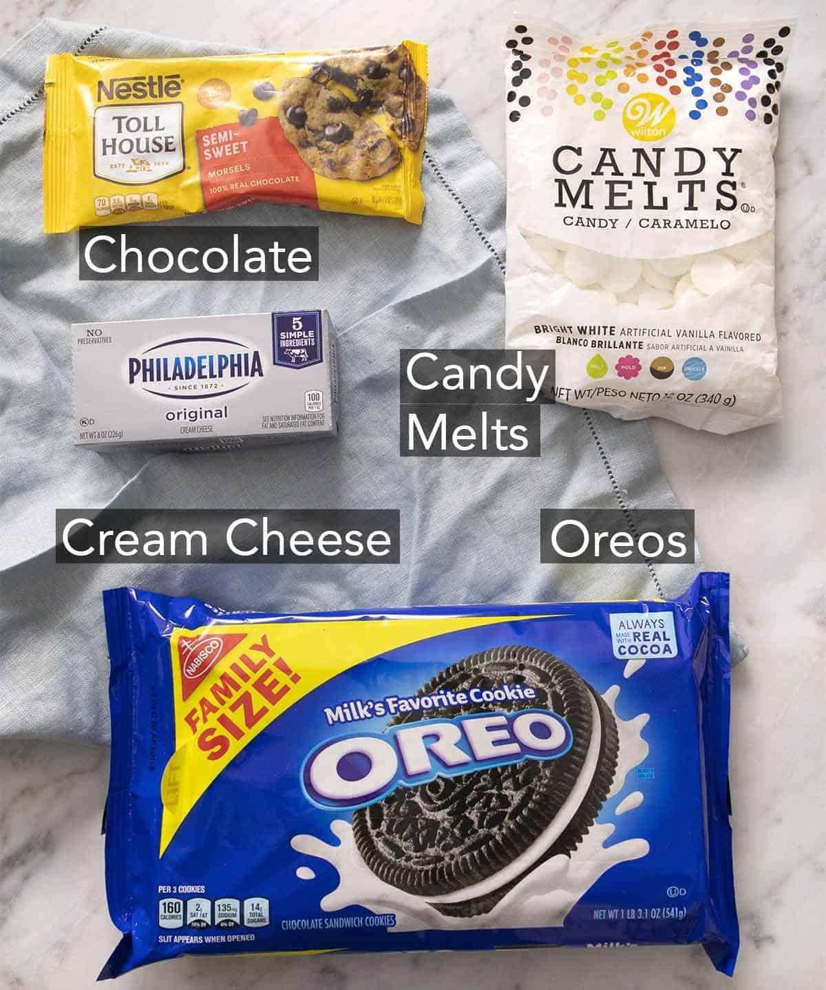 Ingredients to make Oreo Balls on a blue linen napkin.