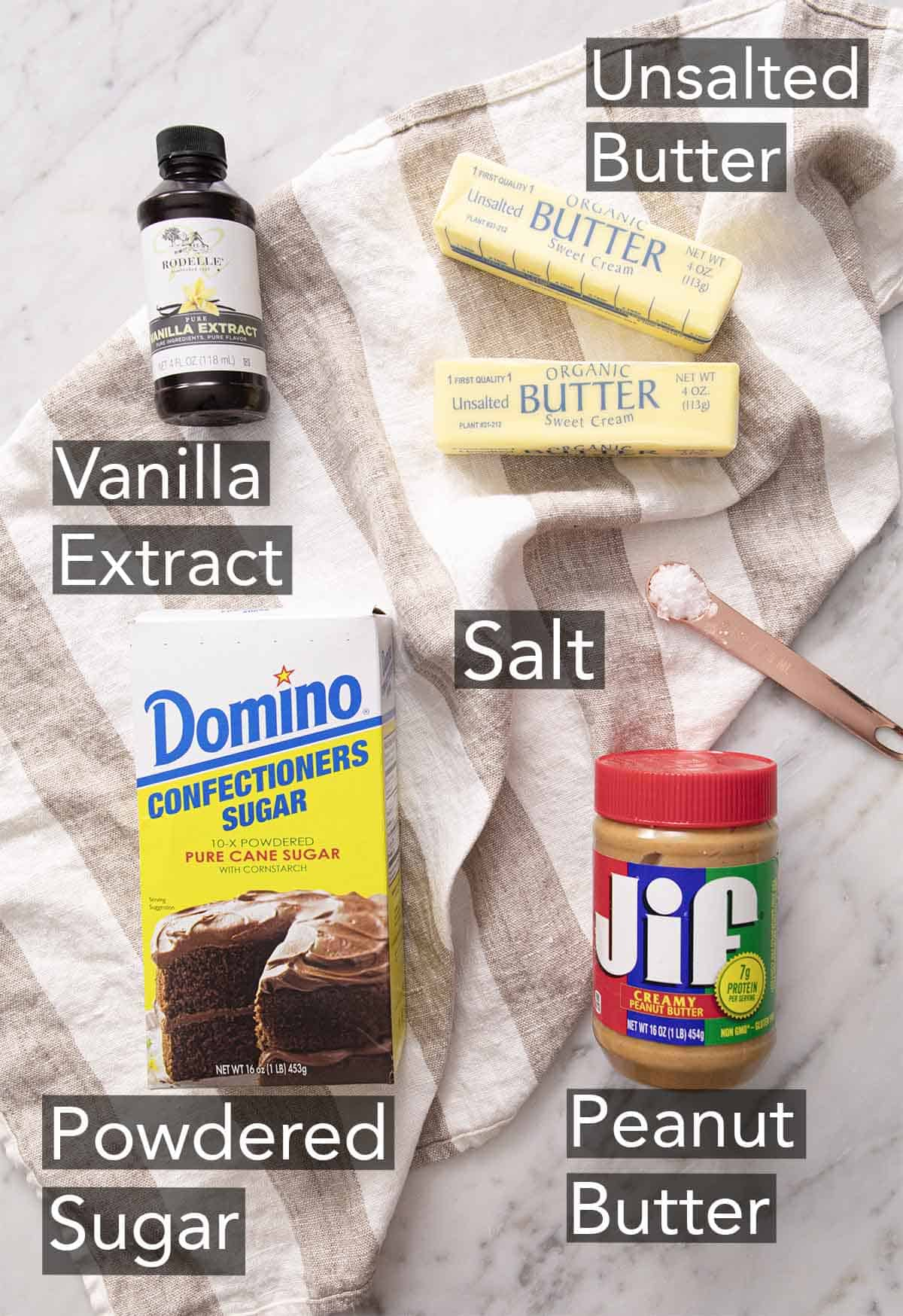 Ingredients to make peanut butter fudge on a marble counter.