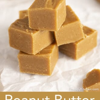 stack of peanut butter fudge on parchment paper