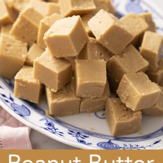 Peanut butter fudge pieces sitting on a blue and white platter