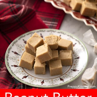 Peanut butter fudge pieces sitting on a christmas plate