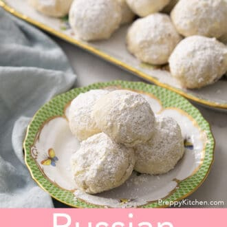 russian tea cakes on a green and white plate