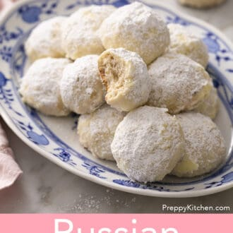 russian tea cakes on a blue and white platter