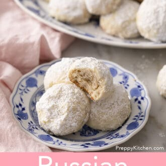 russian tea cakes on a blue and white plate