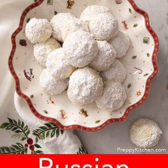 several russian tea cakes on a plate decorated with a christmas scene