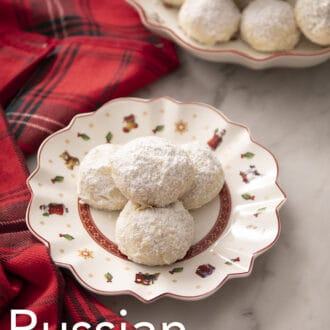 russian tea cakes on a christmas themed plate with a plaid napkin