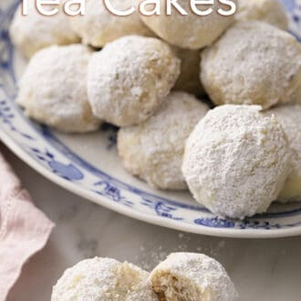 russian tea cakes on a blue and white patterned plate