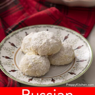 russian tea cakes on a plate decorated with a christmas scene
