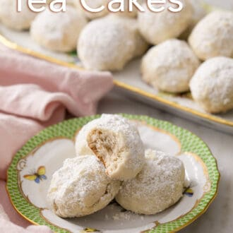 3 russian tea cakes sitting on a plate