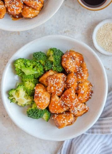 Sesame chicken in a bowl with broccoli