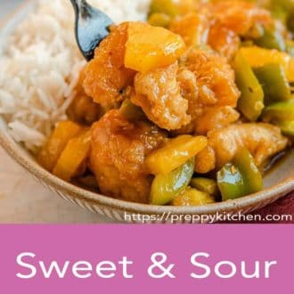 sweet and sour chicken in a bowl with fork