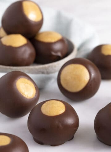 close up of buckeyes on a white surface