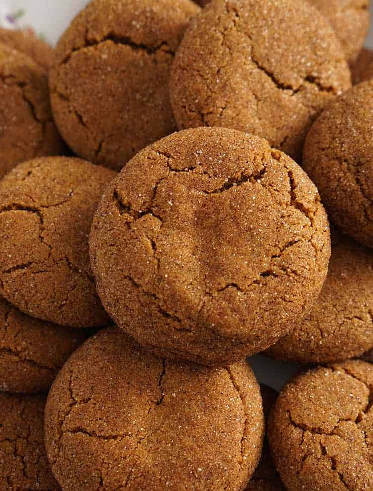 Ginger snap cookies clowe up showing the sugar they're been coated with.