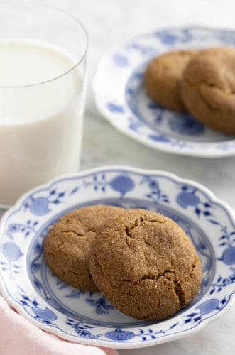 Ginger snap cookies on blue and white plates.