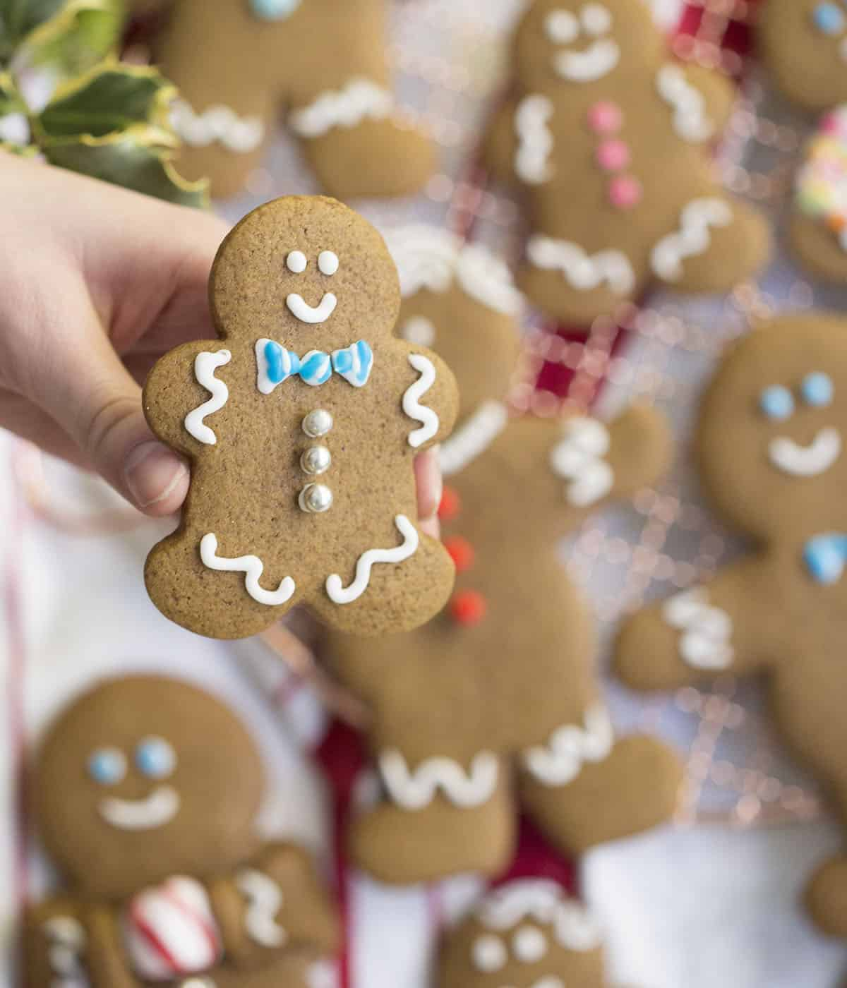 A gingerbread cookie held in the air.