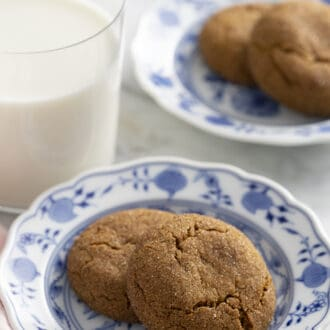 gingersnap cookies sitting on a blue and white plate