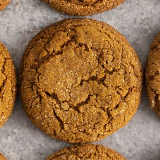 Molasses cookies on a gray surface.