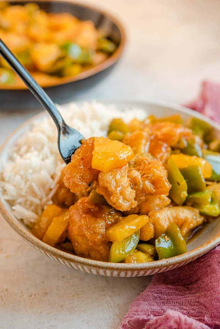 Sweet and sour chicken on a fork