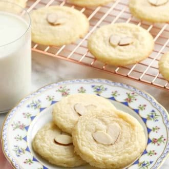 stack of almond cookies on a plate