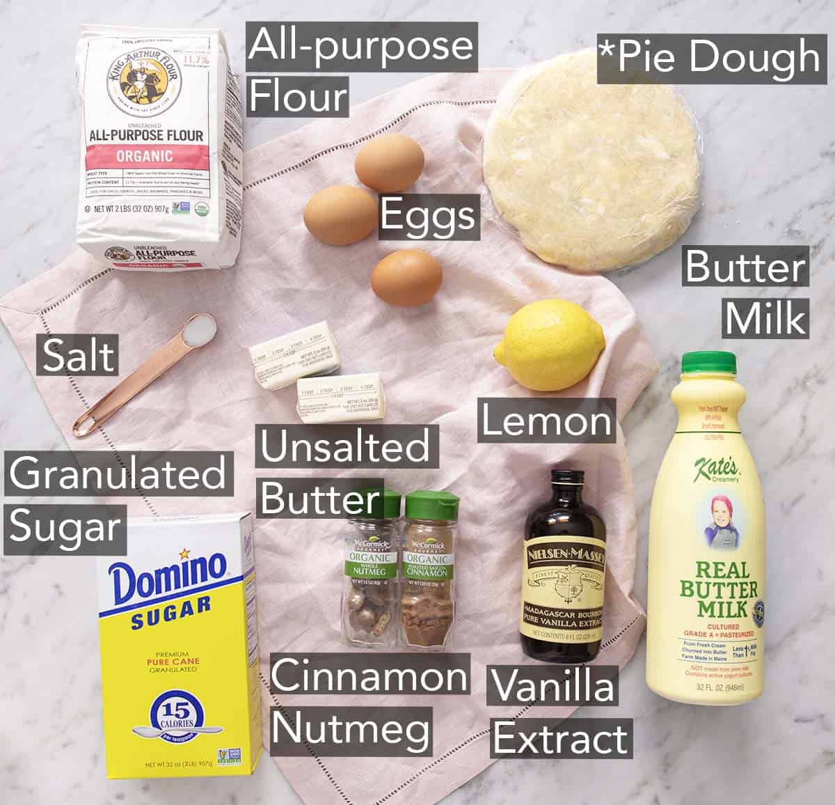 Ingredients to make buttermilk pie on a marble counter.