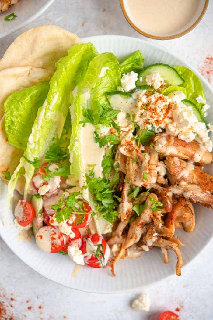 A close up of chicken shawarma in a bowl