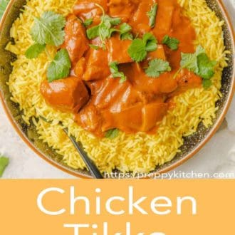 chicken tikka masala in a bowl with fork