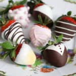 Various types of chocolate covered strawberries mare with white and dark chocolate on a plate